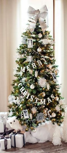 Snowflake inspired Christmas tree. Adorn your Christmas tree with falling snowflakes amidst greeting garlands and various other pretty silver and gold Christmas tree ornaments.