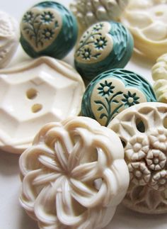 Vintage white buttons and aqua buffed celluloid - .