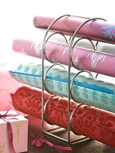 {DIY Wine Rack as Paper Storage}. Organize rolls of paper by slipping them into a wine rack. It keeps the papers tidy and prevents them from wrinkling or bending. Organisation Hacks, Storage Hacks, Craft Organization, Storage Ideas, Creative Storage, Wrapping Paper Storage, Wrapping Papers, Ribbon Storage, Fabric Storage