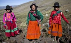 Andean girls pose for a picture during the harvest of native potatoes in the Pomacochas district of the department of Apurimac on May 26, 2014. Peru is the country with the greatest diversity of potatoes in the world, with some 3,800 types, all of which have their place in Peruvian cuisine. (Ernesto Benavides/AFP/Getty Images)