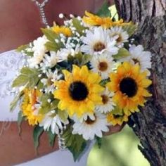 Wedding bouquet!! Sunflowers and daisies. Love love!!