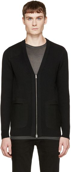 Long sleeve wool-blend cardigan in black featuring felted wool patches. Ribbing throughout. Y-neck collar. Zip closure and patch pockets at front. Patch at elbows. Tonal stitching.