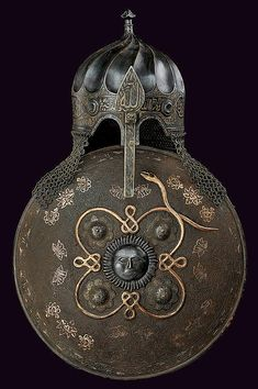 Not strictly Hungarian but the Ottoman inhabited Hungary so its relavence to style and motif found in Hungarian culture is strong. The century style turban helmet and sipar (shield), century. Ancient Armor, Medieval Armor, Style Turban, Chateau Moyen Age, Empire Ottoman, Samurai, Armadura Medieval, Arm Armor, Islamic Art