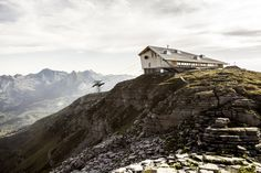 Architects Herzog & de Meuron have created a timber-framed structure cliff restaurant perched on the top of Chäserrugg mountain, within a cable-car station