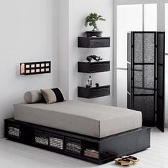 Black and White Decor Featuring Single Mattress with Black Wire Basket Under Drawers.