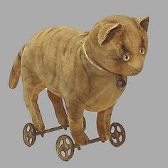 Antique toy cat on wheels.