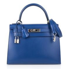 For Sale on - Guaranteed authentic Hermes Kelly 28 Sellier features vivid rich Blue Electric in luxurious Tadelakt leather. This iconic Hermes bag is timeless and chic. Hermes Birkin, Hermes Kelly Bag, Hermes Bags, Hermes Handbags, Fashion Handbags, Hermes Shoes, Hermes Lindy, Tadelakt, Blue Bags