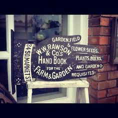 Vintage garden shop sign available at Sis & Moon's.