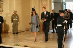 The royal couple prepare to lay posies on the Tomb of the Unknown Australian Soldier