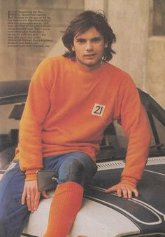 Circa 1975/76. Struggling Chelsea appoint teenager Ray Wilkins as their new captain by picturing him on the bonnet of his car! Ray's long lost locks had never been longer..