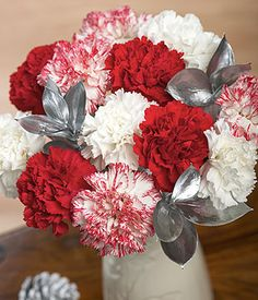 Christmas Candy...A Christmas arrangement of red, white and candy stripe Columbian Carnations with silver Ruscus leaf. #bunchesuk