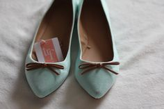 leather bows on seafoam green