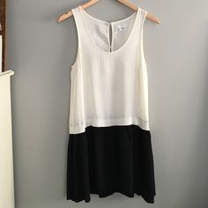 Urban Outfitters flapper dress Great condition; like new! Ivory and black. 100% rayon. Buttons on back. Drop waist. Medium. This has an oversized loose fit and can easily fit a women's 4-6. Urban Outfitters Dresses