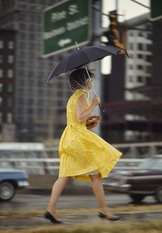A woman in a yellow dress uses an umbrella to keep dry in Saint Louis, Missouri, November 1965.Photograph by Bruce Dale, National Geographic... beauti fashion, missouri, saint louis, novemb 1965, umbrella, dresses, yellow dress, blusteri, bruce dale