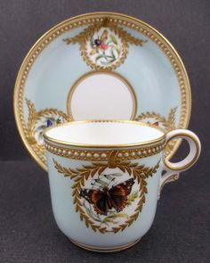 Antique jewelled porcelain cup and saucer set by Royal Worcester, England