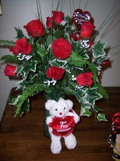 Valentine arrangement with bear and roses.