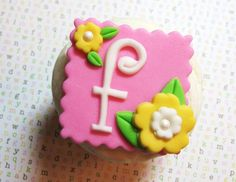 Square whimsy letter with flowers and leaves fondant cupcake topper.