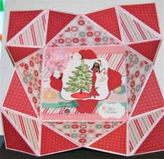 """This is a napkin fold card I made using Close to my Heart paper called """"jingle"""" and stamp set called """"Ms Holiday""""    you can click on the image to see my youtube video on how to make your own napkin fold card."""