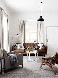 I think I heart Eve Wilson ... BROWN LEATHER AND IS THAT OUR IKEA LAMP?