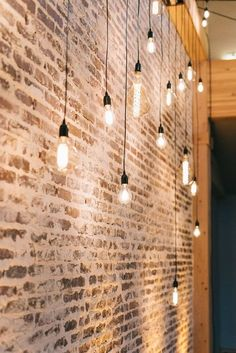 Paper Starlights can be easily installed in your over your own existing pendant light fittings. Here multiple are placed against an exposed brick wall for an look. Industrial Light Fixtures, Hanging Lights, Trendy Lighting, Edison Light Bulbs, Rustic Lighting, Rustic Living Room, Living Room Lighting, Industrial Livingroom, Brick Wall Decor