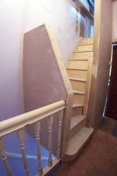 Space saving staircase positioning and design