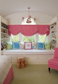 Window seat, built in bookcases & love the window treatment!
