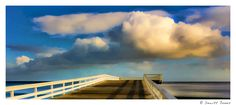 The Pier and the Cloud.   Tension of opposite textures.   Synergy of similar colors.   From Dewitt Jones at http://www.Facebook.com/dewittjonesfanpage - all images Creative Commons non commercial