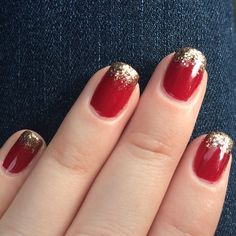 Red nails with gold glitter tips. Perfect for the holidays.