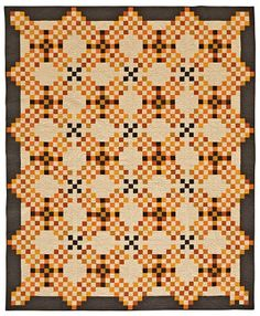 """Midnight Hour quilt by Jo's Country Junction. On the cover of  American Patchwork & Quilting, October 2015. """"This designs came about after sitting at the computer and playing with nine patches."""""""