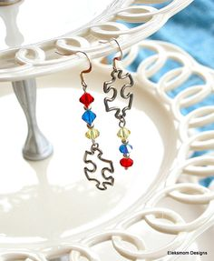 Autism Awareness Earrings in Swarovski crystal and sterling silver.  Hand crafted by Eleksmom Designs.