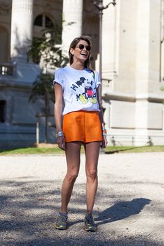 Brights in street style. Mickey Tee and cute orange shorts at Paris Fashion Week Spring 2015 #pfw