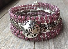 This 5 coil bracelet is made with stainless steel memory wire - will adjust to the size of your wrist and no chance of breaking. This will ensure you will have this bracelet for a long time. Materials include 4mm plum purple faceted glass crystal beads, 8x12 flat rectangle puffed