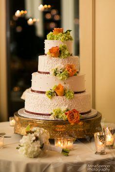 Anna and Spencer Photography , Atlanta Wedding Photographers . White wedding cake with orange roses and green hydrangeas. Pretty Cakes by Meg.