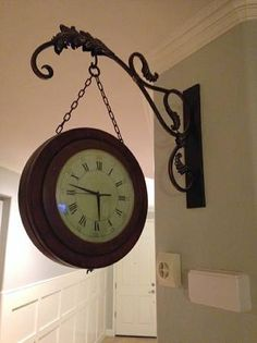 this is a double sided hanging clock with roman numerals the entire set
