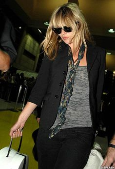 Looks like Kate Moss could wear this shirt with everything. AKA, I need to find something like it.