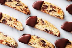 These twice-baked cookies are great for gifting because their dryness allows them to be stored for long periods of time and is less prone to breaking. Pipe or drizzle the melted chocolate onto your cookies, if desired.