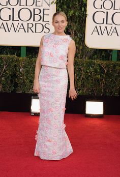 Sienna Miller Skipping the traditional gown, Sienna Miller's custom Erdem Golden Globes look is a breath of fresh air on the red carpet. The trendsetting Brit's white retro-inspired skirt and top feature white lace and light pink and coral floral appliques.Browse retro-inspired wedding dresses.