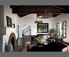 house by diane keaton. Love beams with black window sashes, textured walls and arches.