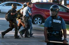 Huffington Post reporter arrested after the police closed the Ferguson McDonalds.