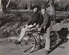 """Carole Lombard props herself atop the handlebars of Donald Haines' bike -- a still from the 1936 Universal screwball romp """"Love Before Breakfast."""""""