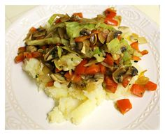 Mashed potatoes topped with sauteed vegetables