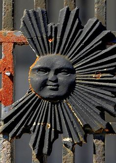 Sun decoration on a gate, St. Louis Cemetery #2, New Orleans