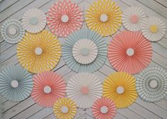 Set of Seventeen (17) Pastel Vintage Circus Inspired  Paper Rosettes, Paper Fans Backdrop