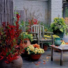 40 Inspiring Fall Patio Decorating Ideas : 40 Cozy Fall Patio Decorating Ideas With Stone Walls Wooden Chair Table Flower Decor Stone Floor
