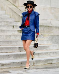 Spotted on the Paris Street Style Scene: a monochrome denim ensemble featuring a statement hat, color block shoes, and a red dress shirt for a pop of color.