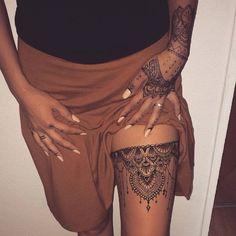 mandala style tattoo on thigh