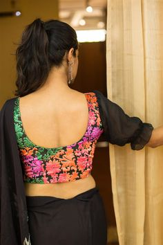 A cool velvet blouse with super feminine sheer gathered sleeves! Multicoloured florals to keep it very versatile and black georgette sheer sleeves in a trendy elbow length with puff detailing for a surprise touch. Pairing options abound…Pair with a saree in any one of the floral colors and shine on! #multicolor #sheer #puffsleeve #blouse #India #saree #houseofblouse