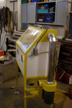 Blasting Cabinet by f350ca -- Homemade blasting cabinet featuring a frame constructed from surplus bedposts and puck boards. The bottom funnel enables sand recycling. Powered by a surplus oil burner fan. http://www.homemadetools.net/homemade-blasting-cabinet-2