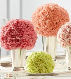 The Garden™ Centerpiece is a lovely way to bring bright, bold clusters of color to your reception. A collection of bouquets featuring a single type of flower, including peach carnations, pink carnatio