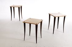 A striking 'Herd' of Tables, in Birds-Eye Maple with Walnut legs. Out grazing!